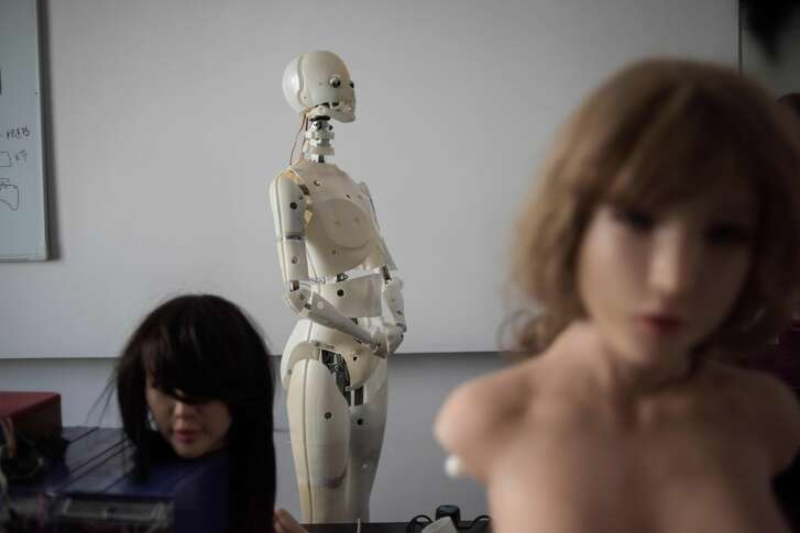 """TOPSHOT - This photo taken on February 1, 2018 shows robots in a lab of a doll factory of EXDOLL, a firm based in the northeastern Chinese port city of Dalian. With China facing a massive gender gap and a greying population, a company wants to hook up lonely men and retirees with a new kind of companion: """"Smart"""" sex dolls that can talk, play music and turn on dishwashers. / AFP PHOTO / FRED DUFOUR / TO GO WITH China-sex-lifestyle, FOCUS by Joanna CHIU        (Photo credit should read FRED DUFOUR/AFP/Getty Images)"""