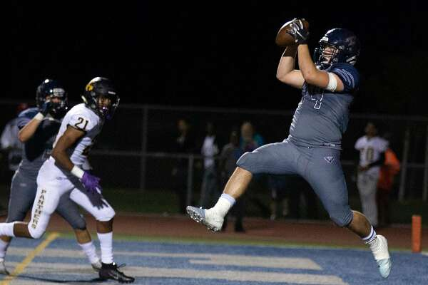Freedom�s Brett Bausola (44) catches a pass for a touchdown in front of Antioch�s Dejuan Butler (21) during the fourth quarter of a BVAL high school football game on Friday, Sept. 21, 2018 in Oakley, Calif. Freedom won 14-7.