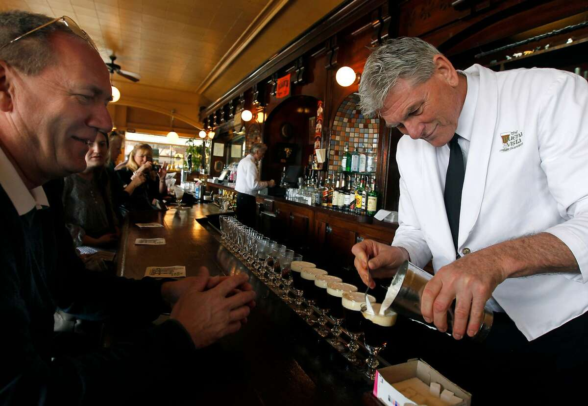 Visitor Michael Smith (left) watches bartender Paul Nolan make an Irish coffee at the Buena Vista Cafe in San Francisco, Calif. on Saturday, April 2, 2011. The venerable watering hole cornered the market on the original glasses when the manufacturer decided to stop making them. They now have a manufacturer in China but, according to management, aren't quite the same quality.