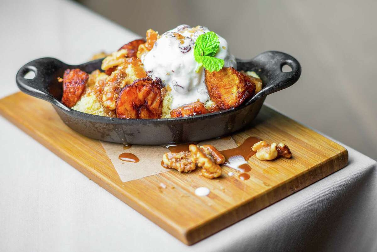 Rum and plantain Foster with vanilla cake, rum-raisin ice cream and candied walnuts at Roost