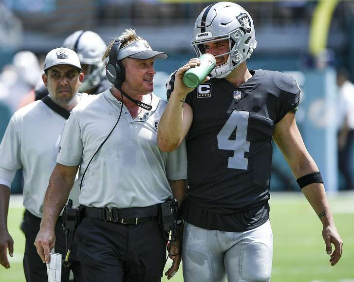 MIAMI, FL - SEPTEMBER 23: Derek Carr #4 of the Oakland Raiders and head coach Jon Gruden of the Oakland Raiders during the second quarter against Miami Dolphins at Hard Rock Stadium on September 23, 2018 in Miami, Florida. (Photo by Mark Brown/Getty Images)