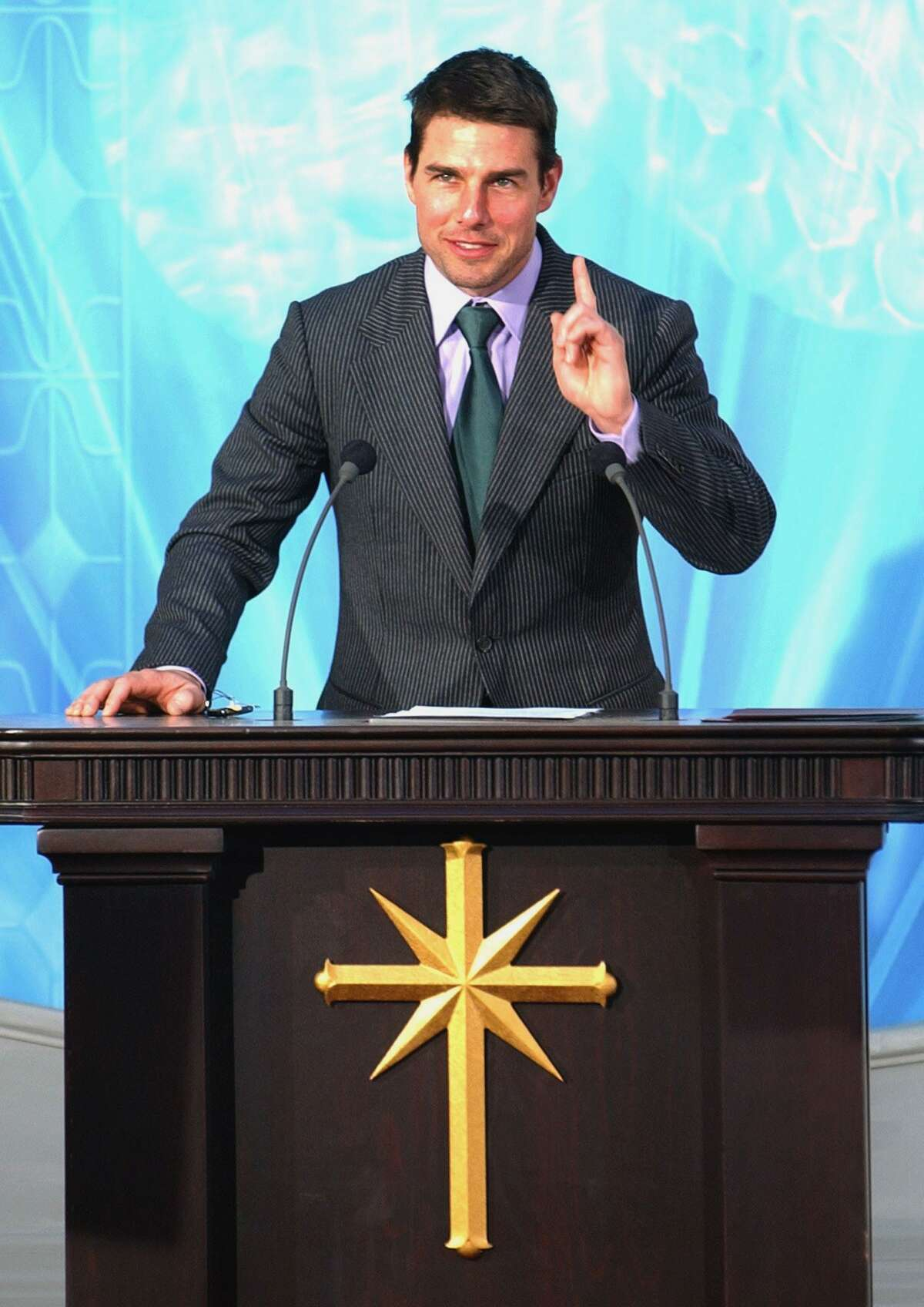 Tom Cruise makes a speech during the official opening of a new Scientology church in central Madrid in 2004.