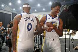 Damian Jones and DeMarcus Cousins during Golden State Warriors' Media Day in Oakland, Calif. on Monday, September 24, 2018.