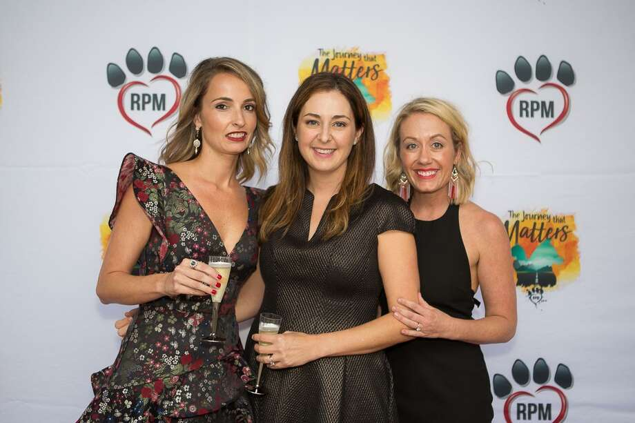 Rescued Pets Movement held its Fur Ball Sept. 20 at House of Blues. The event raised funds for placing homeless cats and dogs with forever families in locations across the United States and Canada. Here, Katie Beirne, Lisa Prati and Katherine Wright celebrate the organization's rescuing nearly 30,000 pets in its first five years. Photo: Courtesy Photo By Rescued Pets Movement / Eric Sauseda/Groovehouse Photogr