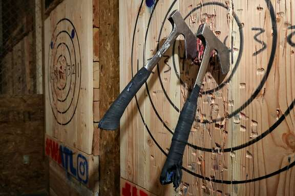 WASHINGTON, DC - MARCH 28:  Throwing hatchets are lodged in a wood target wall at Bad Axe Throwing March 28, 2018 in Washington, DC. Recreational axe throwing is growing in popularity and Bad Axe, which is moving next month to a bigger space in the District of Columbia, has more than twenty locations in the United States and Canada.  (Photo by Chip Somodevilla/Getty Images)