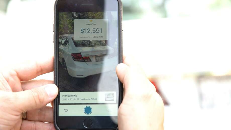USAA is piloting an augmented reality app designed to make the car-shopping experience easier for its customers. By pointing their cellphone at a vehicle, customers can get information like the make, model and price range. Photo: USAA