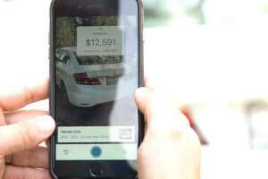 USAA is piloting an augmented reality app designed to make the car-shopping experience easier for its customers. By pointing their cellphone at a vehicle, customers can get information like the make, model and price range.