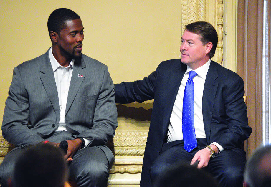 SIUE men's basketball coach Jon Harris, left, talks to Saint Louis University coach Travis Ford during Monday's College Basketball Tip-Off Luncheon at the Missouri Athletic Club. Photo: Scott Marion