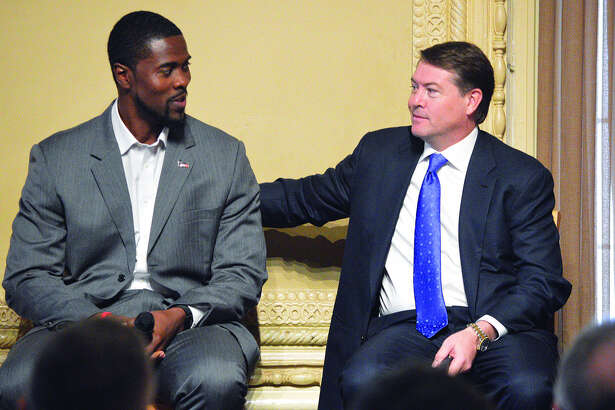 SIUE men's basketball coach Jon Harris, left, talks to Saint Louis University coach Travis Ford during Monday's College Basketball Tip-Off Luncheon at the Missouri Athletic Club.
