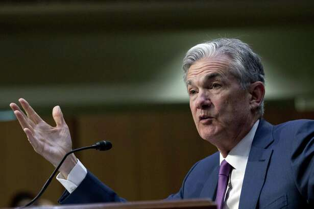 "In this July 17, 2018, file photo Federal Reserve Board Chair Jerome Powell testifies before the Senate Committee on Banking, Housing, and Urban Affairs on ""The Semiannual Monetary Policy Report to the Congress,"" at Capitol Hill in Washington. The Federal Reserve will surprise no one if it does Wednesday, Sept. 26, what its poised to do for a third time this year: Raise its key short-term interest rate by a modest quarter-point to help keep inflation in check, and signal that another hike is likely in December."