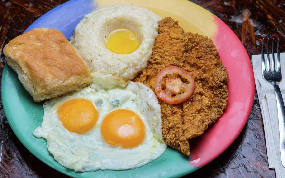 Catfish and grits with sunny side up eggs and a biscuit at The Breakfast Klub