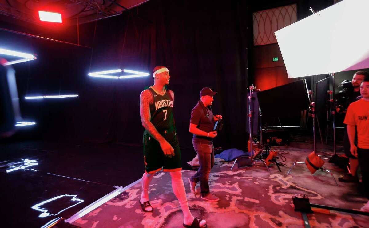 Houston Rockets forward Carmelo Anthony (7) leaves after having a video taken during their Media Day at the Post Oak Hotel Monday, Sept. 24, 2018, in Houston.