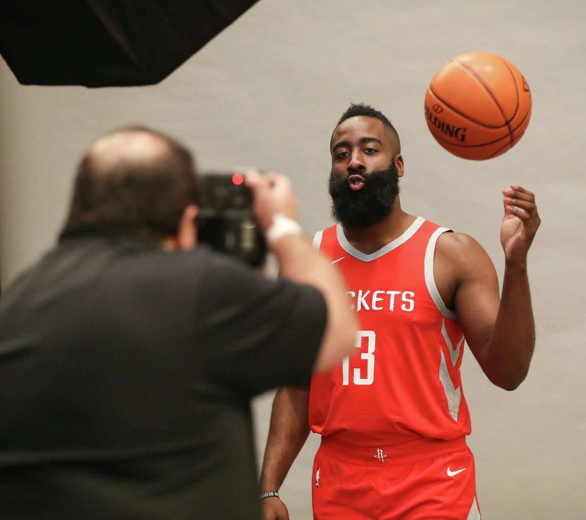 Houston Rockets guard James Harden (13) has his photo taken by Troy Taormina during their Media Day at the Post Oak Hotel Monday, Sept. 24, 2018, in Houston.