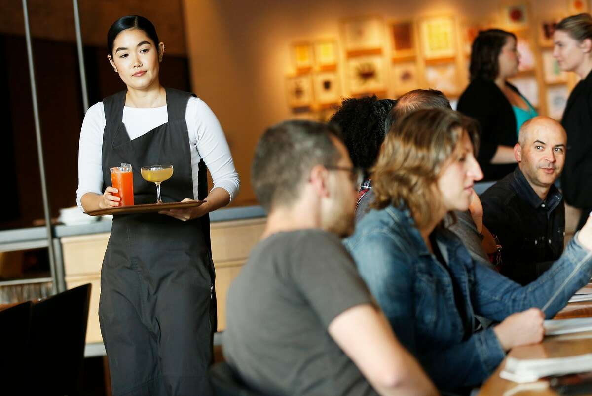 Vanessa Lorig serves customers at In Situ at SFMOMA, Friday, Sept. 21, 2018, in San Francisco, Calif. The restaurant does not have the 6% S.F. Mandates surcharge.