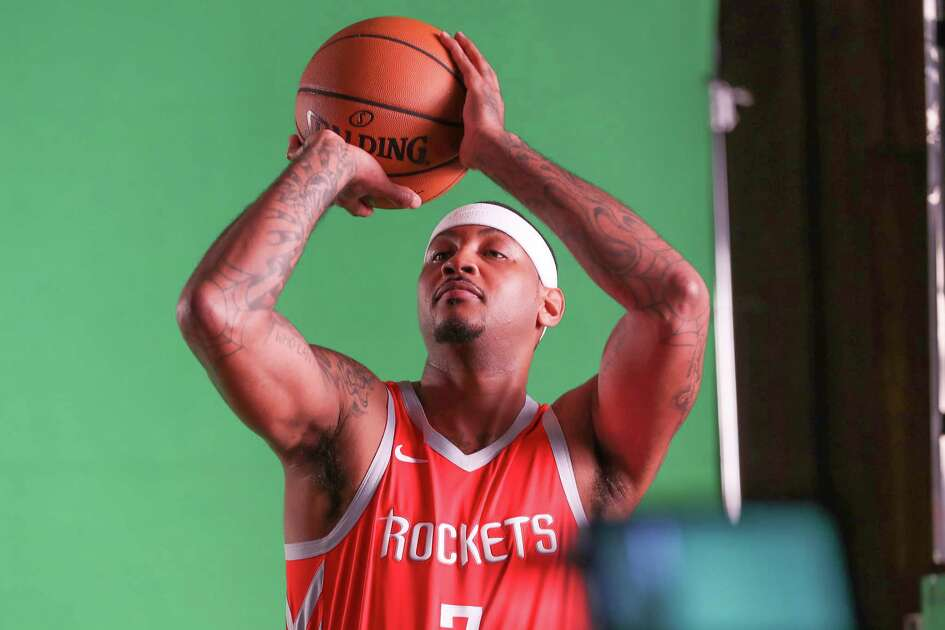 Houston Rockets forward Carmelo Anthony (7) has a video taken during their Media Day at the Post Oak Hotel Monday, Sept. 24, 2018, in Houston.