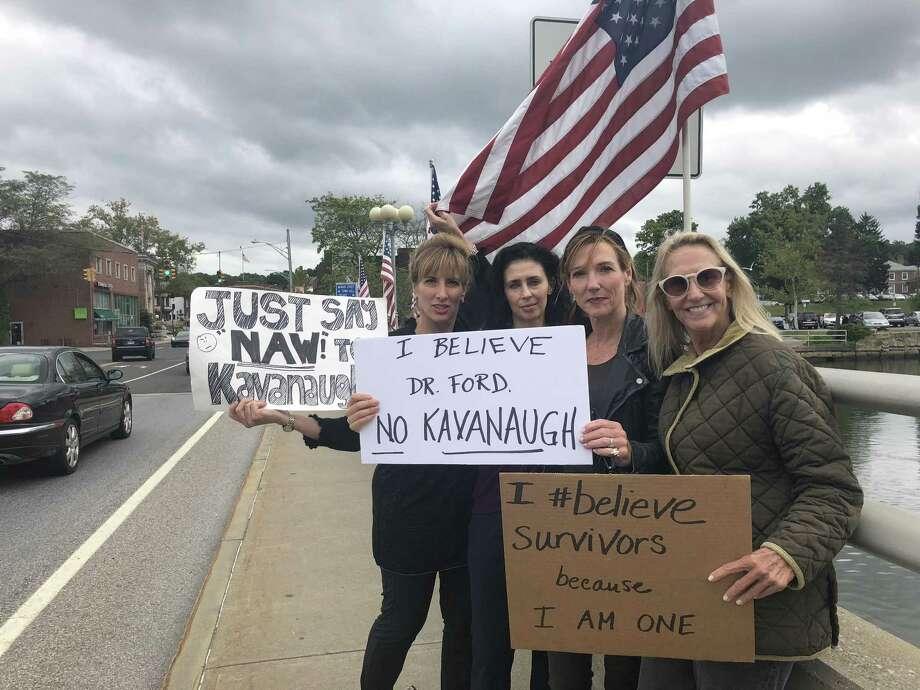 Westport women protest Supreme Court nominee Brett Kavanaugh at the Ruth Steinkraus-Cohen Bridge in Westport around 1 p.m. on Sept. 24. Photo: Contributed Photo