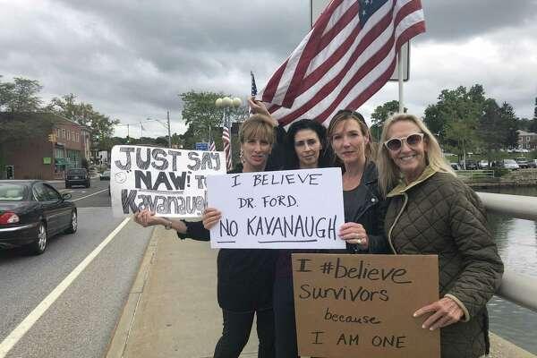 Westport women protest Supreme Court nominee Brett Kavanaugh at the Ruth Steinkraus-Cohen Bridge in Westport around 1 p.m. on Sept. 24.