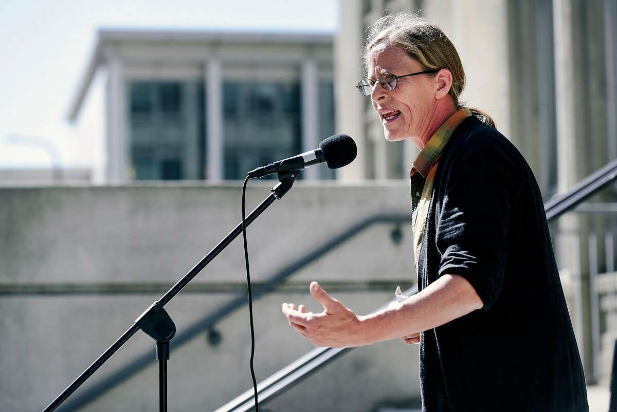 Andrea Prichett, founder of Cop Watch, speaks during a rally outside City Hall in Berkeley.