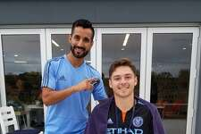 New York City F.C. midfielder Maxi Moralez poses with fan Matt DePrima.