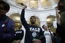 Yale student Jishian Ravinthiran, center, raises his fist during a protest against Judge Brett Kavanaugh in the Russell Senate Office Building Rotunda, on Capitol Hill, Monday, Sept. 24, 2018 in Washington. A second allegation of sexual misconduct has emerged against Judge Brett Kavanaugh, a development that has further imperiled his nomination to the Supreme Court, forced the White House and Senate Republicans onto the defensive and fueled calls from Democrats to postpone further action on his confirmation. President Donald Trump is so far standing by his nominee.