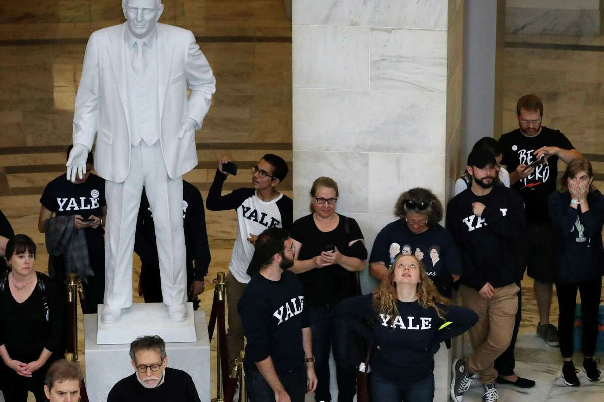 Hundreds of protesters rally in the Russell Senate Office Building Rotunda while demonstrating against the confirmation of Judge Brett Kavanaugh on Capitol Hill September 24, 2018 in Washington, DC. Hundreds of people from half a dozen progressive organizations, including students from Yale University Law School, protested on Capitol Hill for a #BelieveSurvivors Walkout against Judge Kavanaugh, who has been accused by at least two women of sexual assault.