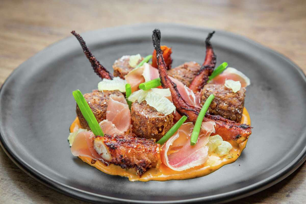 Charred octopus with Bacalao tater tots, piquillo aioli and jamon serrano at Provisions
