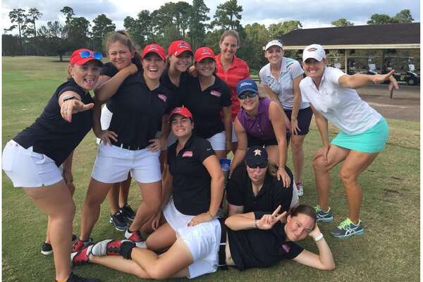 Lamar golf players pose for a picture with alumni. Photo provided by Lamar athletics.