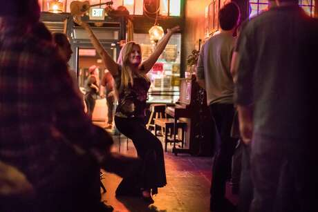 Rachel Cepeda dances to the music of the Ghost-Note band at Ivy Room on Saturday, Sept. 22, 2018, in Albany, Calif.