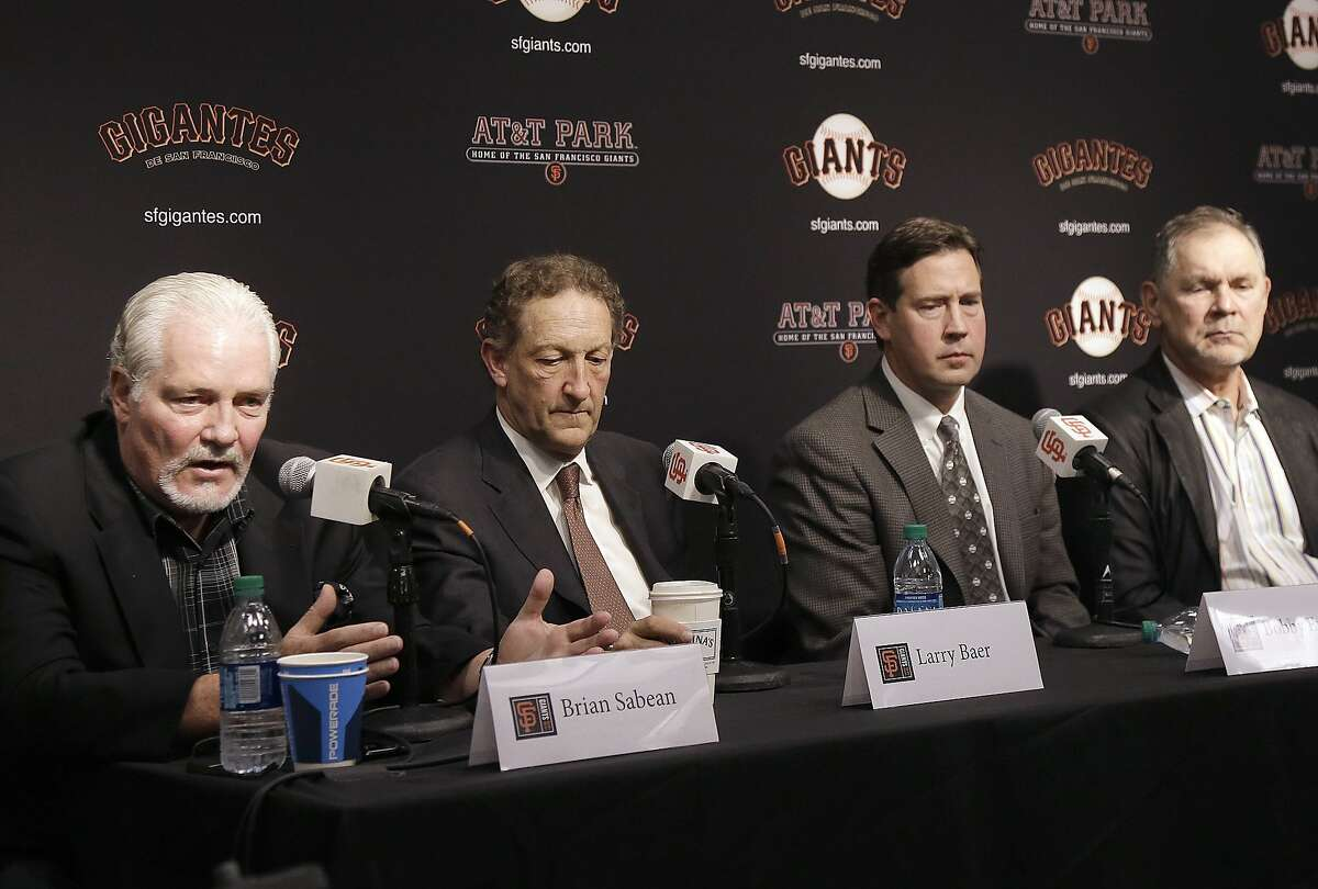 San Francisco Giants executive vice president of baseball operations Brian Sabean, from left, speaks next to CEO Larry Baer, general manager Bobby Evans and manager Bruce Bochy at a news conference in San Francisco, Tuesday, Oct. 3, 2017. (AP Photo/Jeff Chiu)