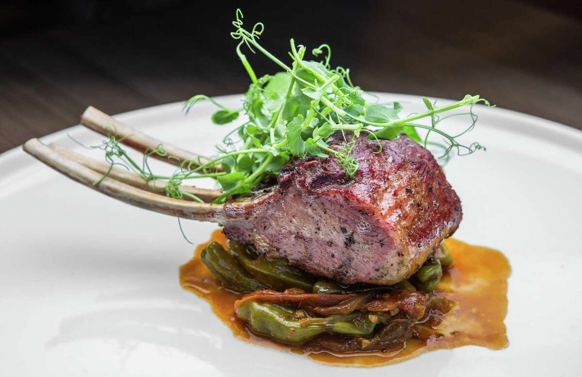Oak-grilled lamb chops with roasted tomato and shishito pepper chutney at Weights + Measures