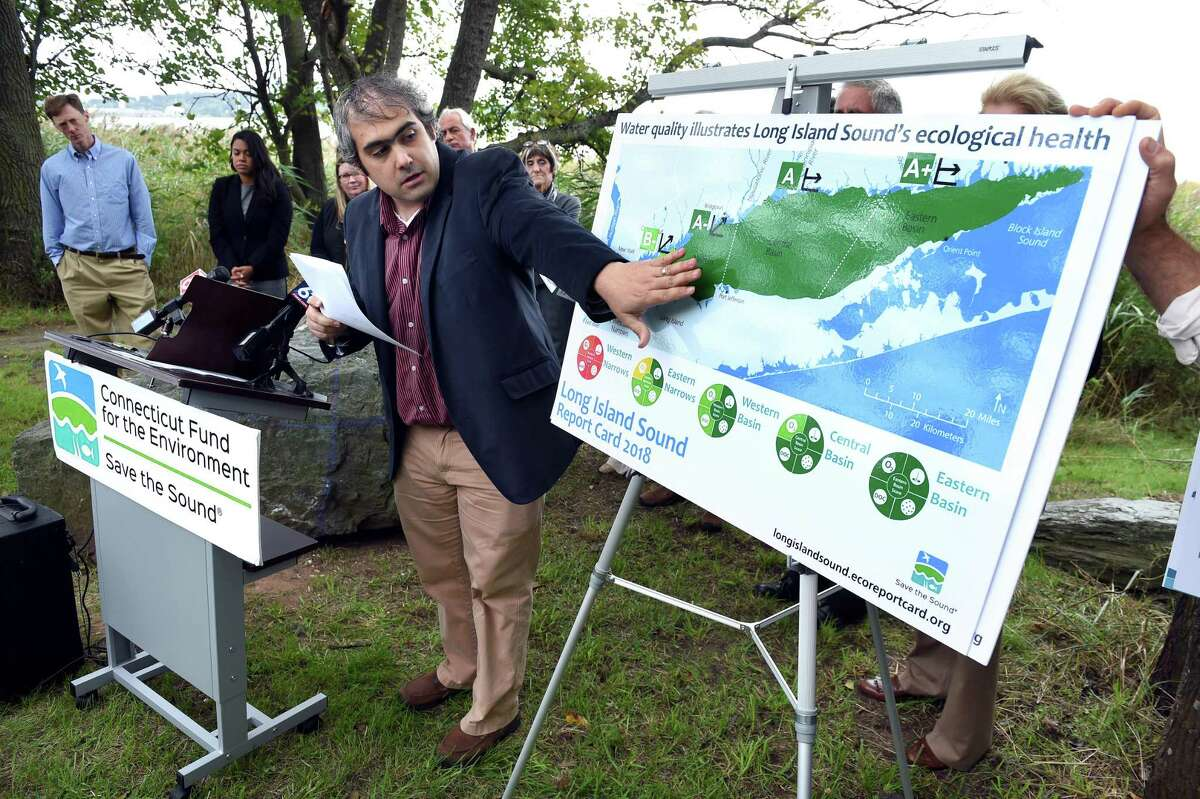 Jason Krumholz, senior environmental scientist at McLaughlin Research Corporation, talks about the 2018 Long Island Sound report card during a press conference at the Long Wharf Nature Preserve in New Haven on Monday.