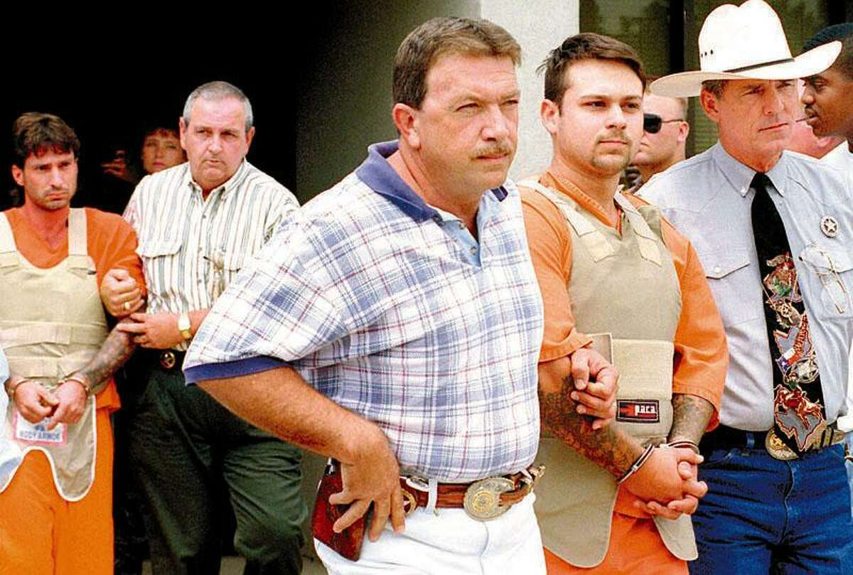 Lawrence Russell Brewer, back left, and John William King, right, are taken from the Aubrey Cole Law Enforcement Center in Jasper to appear before the district attorney at the Jasper County Courthouse on June 9, 1998. Brewer, King and a third defendant were later convicted in the dragging death of James Byrd Jr. Enterprise file photo