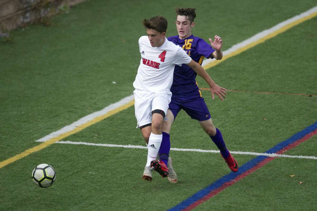 Fairfield Warde sophomore Alex Kagan shields Westhill High School junior Tiernan Duffy while chasing after the ball during a varsity boys soccer game at Westhill in Stamford, Conn. on Monday, Sept. 24, 2018. Fairfield Warde defeated Westhill 3-2.