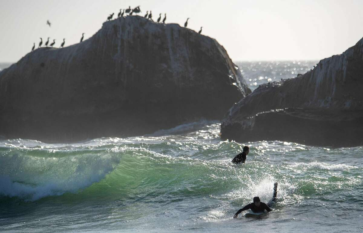 A surfer catches a wave at Martin's Beach in Half Moon Bay, California on September 19, 2018. - Billionaire Vinod Khosla purchased the land and has been limiting access and charging fees to the general public in order to be able to enjoy the beach. (Photo by JOSH EDELSON / AFP)JOSH EDELSON/AFP/Getty Images