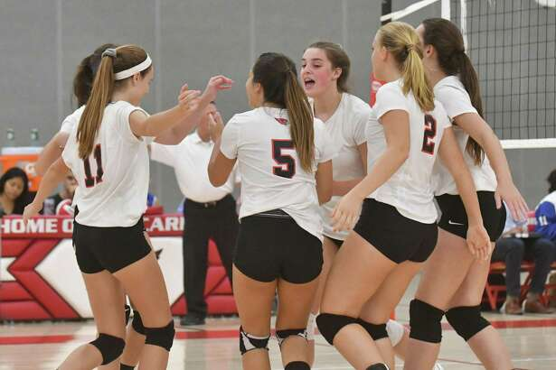 The Greenwich Cardinals react after scoring a point during Monday's 3-2 win over Ludlowe.