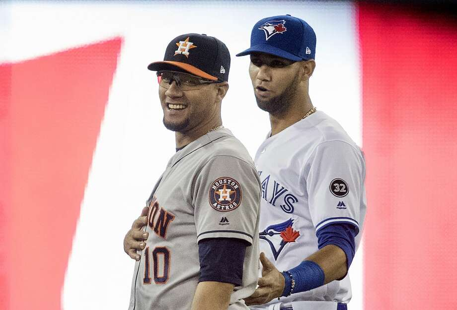 Toronto Blue Jays' Lourdes Gurriel Jr., right,  and his brother, Houston Astros first baseman Yuli Gurriel, talk just prior to a baseball game in Toronto, Monday Sept. 24, 2018. (Fred Thornhill/The Canadian Press via AP) Photo: Fred Thornhill/Associated Press