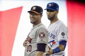 Toronto Blue Jays' Lourdes Gurriel Jr., right, and his brother, Houston Astros first baseman Yuli Gurriel, talk just prior to a baseball game in Toronto, Monday Sept. 24, 2018. (Fred Thornhill/The Canadian Press via AP)