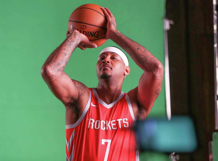 Rockets forward Carmelo Anthony participates in a video shoot during the team's Media Day on Monday.