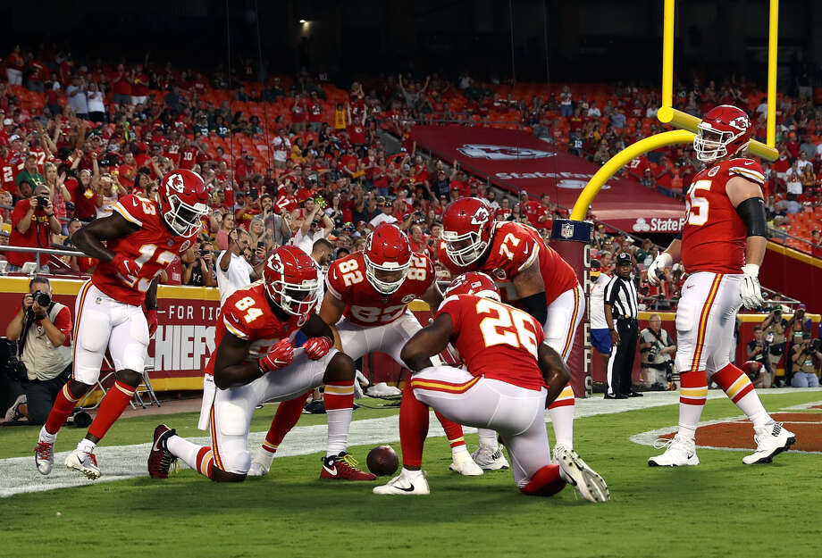 Midland High alum Andrew Wylie (77) and his Kansas City Chiefs' teammates celebrate a touchdown vs. the Green Bay Packers during an NFL preseason game on Aug. 30 in Kansas City. Photo: Getty Images