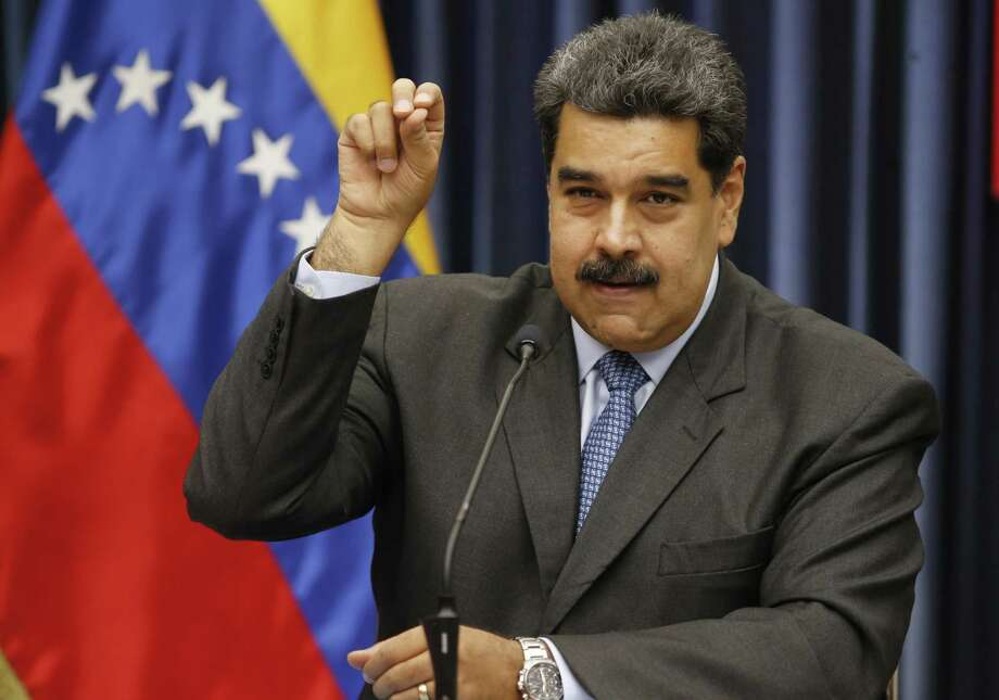 Venezuela's President Nicolas Maduro demonstrates his Salt Bae sprinkling technique during a press conference at the Miraflores Presidential Palace, in Caracas, Venezuela, Tuesday, Sept. 18, 2018. Maduro demonstrated the technique after speaking about the invitation to the famed Nusr-Et steakhouse in Istanbul when he stopped over briefly in Turkey on the way home from a trip to China to raise badly needed investment.  Videos of Maduro feasting on a steak is drawing fury from opponents of the embattled socialist leader. (AP Photo/Ariana Cubillos) Photo: Ariana Cubillos /Associated Press / Copyright 2018 The Associated Press. All rights reserved.
