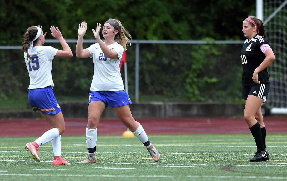 Mercy's Kaila Lujambio, left, celebrates with Lindsay Stevenson after Stevenson scored a goal against Law on Monday in Milford. Photo: Arnold Gold / Hearst Connecticut Media / New Haven Register