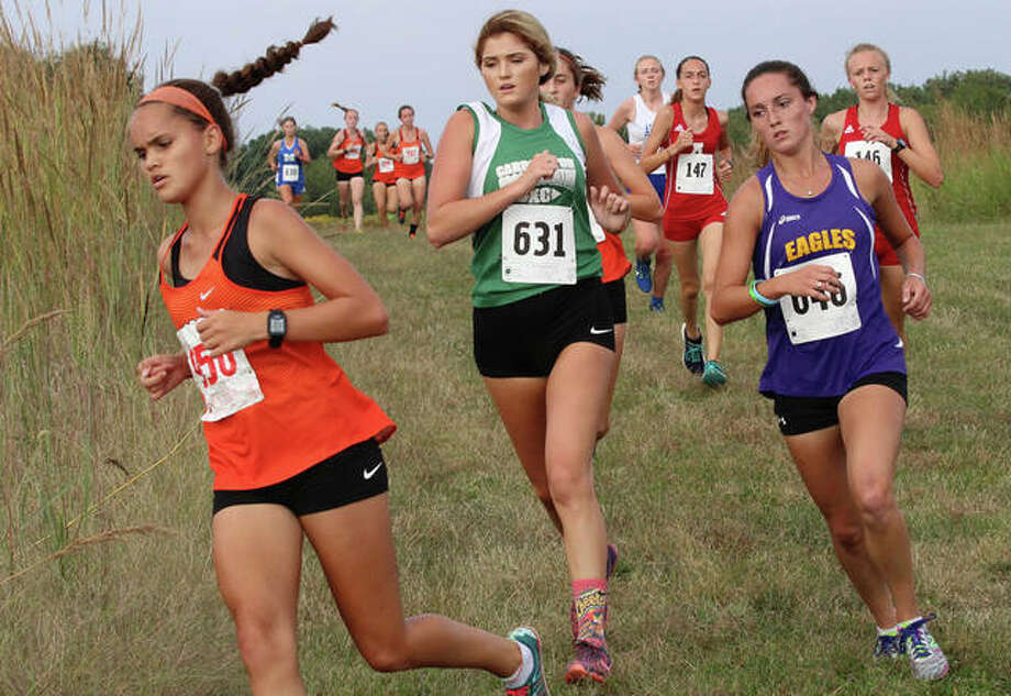 Edwardsville's Jillian Welsh turns a corner ahead of Carrollton's Lily Baumgartner (631) and CM's Kati Wells (right) about a mile into the three-mile Havens Invitational cross country meet Monday at Principia College in Elsah. Photo: Greg Shashack / The Telegraph