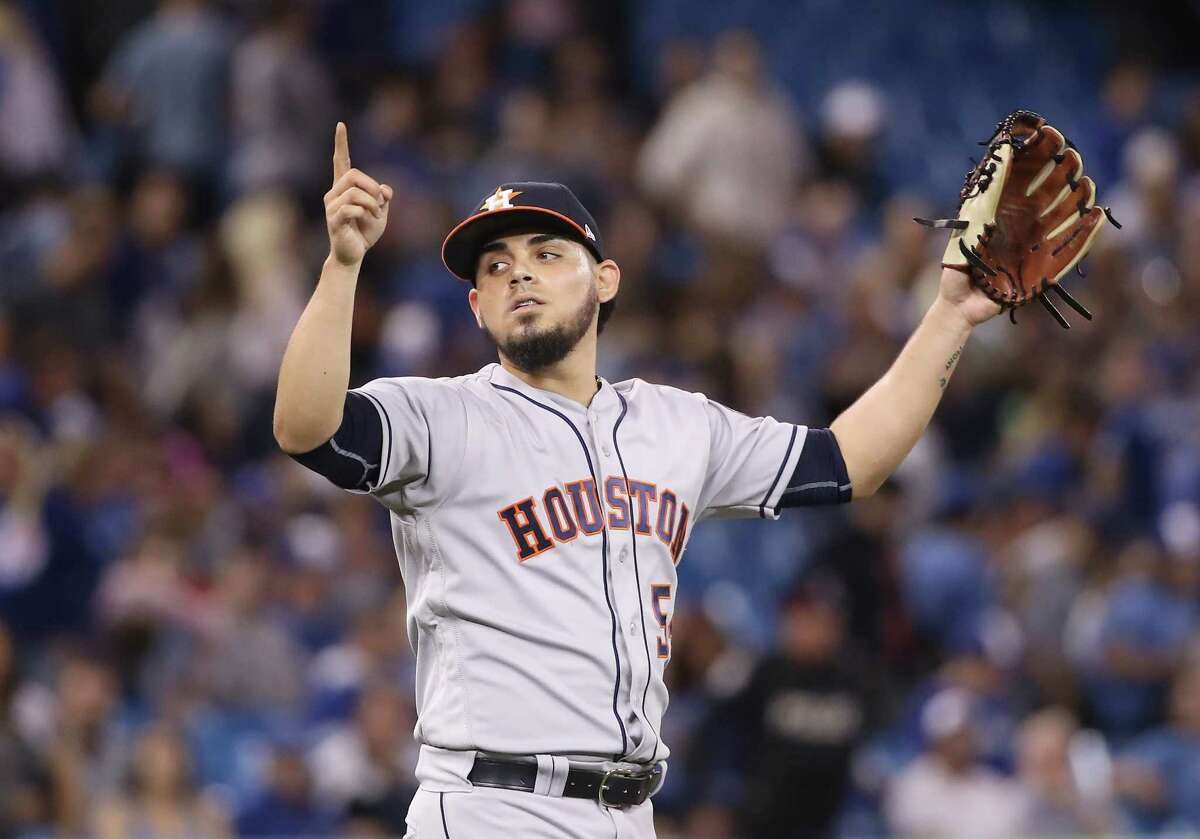 TORONTO, ON - SEPTEMBER 24: Roberto Osuna #54 of the Houston Astros celebrates after getting the final out of the game during MLB game action against the Toronto Blue Jays at Rogers Centre on September 24, 2018 in Toronto, Canada.