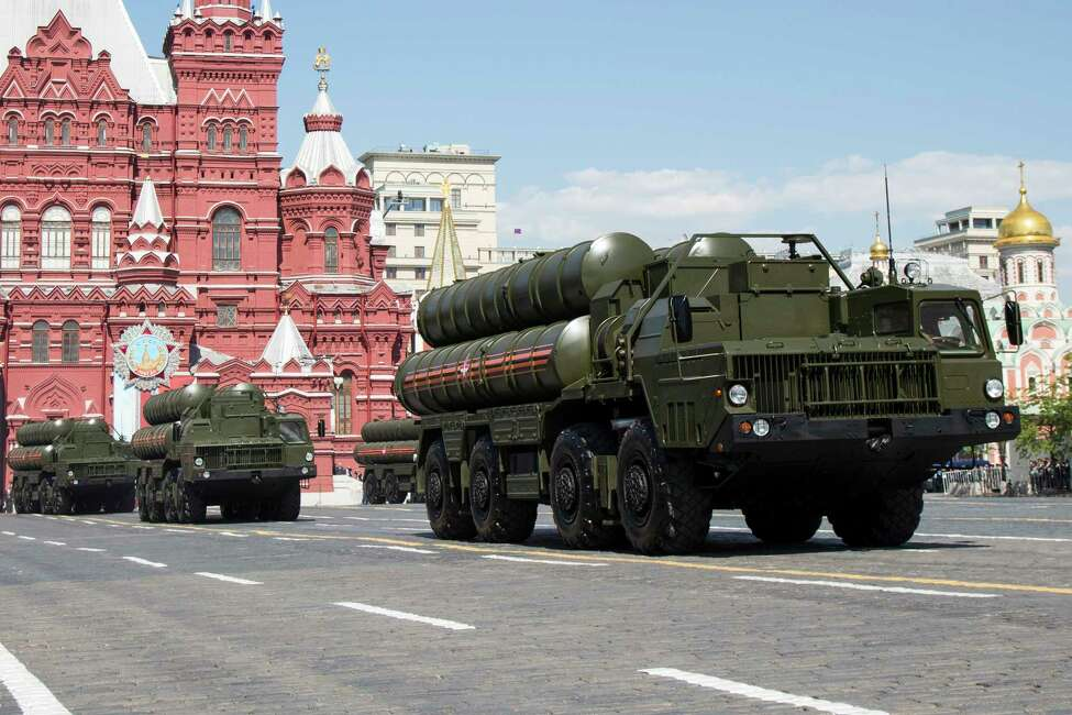 FILE In this file photo taken on Monday, May 9, 2016, Russian the S-300 air defense missile systems drive during the Victory Day military parade marking 71 years after the victory in WWII in Red Square in Moscow, Russia. Moscow will supply the Syrian government with modern S-300 missile defense systems following last week?'s downing of a Russian plane, the Russian Defense Minister announced on Monday Sept. 24, 2018.(AP Photo/Alexander Zemlianichenko, File)