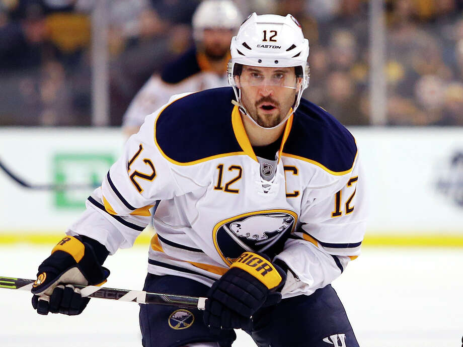 FILE - In this Feb. 6, 2016, file photo, Buffalo Sabres' Brian Gionta is shown during the first period of an NHL hockey game against the Boston Bruins, in Boston. A person with direct knowledge of forward Brian Gionta's decision tells The Associated Press the former Montreal Canadiens and Buffalo Sabres captain, and two-time United States Olympian will announce he's retiring after 16 NHL seasons. The person spoke to The AP on the condition of anonymity Monday, Sept. 24, 2018, because Gionta hasn't publicly revealed what he plans to announce during a news conference scheduled for later in the day at the Sabres downtown arena. (AP Photo/Winslow Townson, File) Photo: Winslow Townson / FR170221 AP