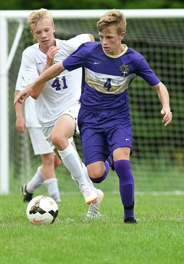 Christian Brothers Academy Jordon Proulx (4) and Ballston Spa's Liam O'Connell (41) chase a loose ball during a Section II boys' soccer game Tuesday, Sept. 11, 2018, in Colonie, N.Y. (Hans Pennink / Special to the Times Union) Photo: Hans Pennink / Hans Pennink