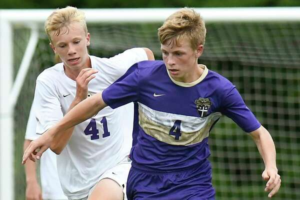 Christian Brothers Academy Jordon Proulx (4) and Ballston Spa's Liam O'Connell (41) chase a loose ball during a Section II boys' soccer game Tuesday, Sept. 11, 2018, in Colonie, N.Y. (Hans Pennink / Special to the Times Union)
