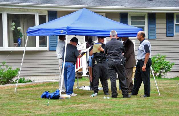Investigators gather at 9403 Route 66 in Poestenkill, the scene of a triple shooting Tuesday,  July 13, 2010.  (John Carl D'Annibale / Times Union) Photo: John Carl D'Annibale
