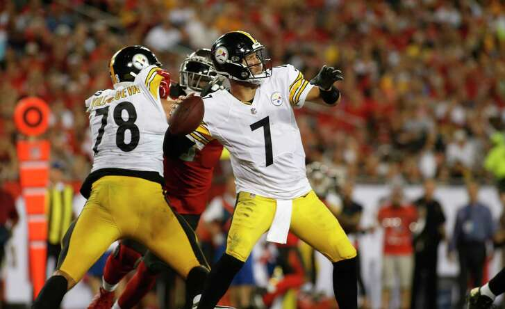 TAMPA, FL - SEPTEMBER 24:  Quarterback Ben Roethlisberger #7 of the Pittsburgh Steelers gets some protection from offensive tackle Alejandro Villanueva #78 as he throws to an open receiver during the second quarter of a game against the Tampa Bay Buccaneers on September 24, 2018 at Raymond James Stadium in Tampa, Florida.