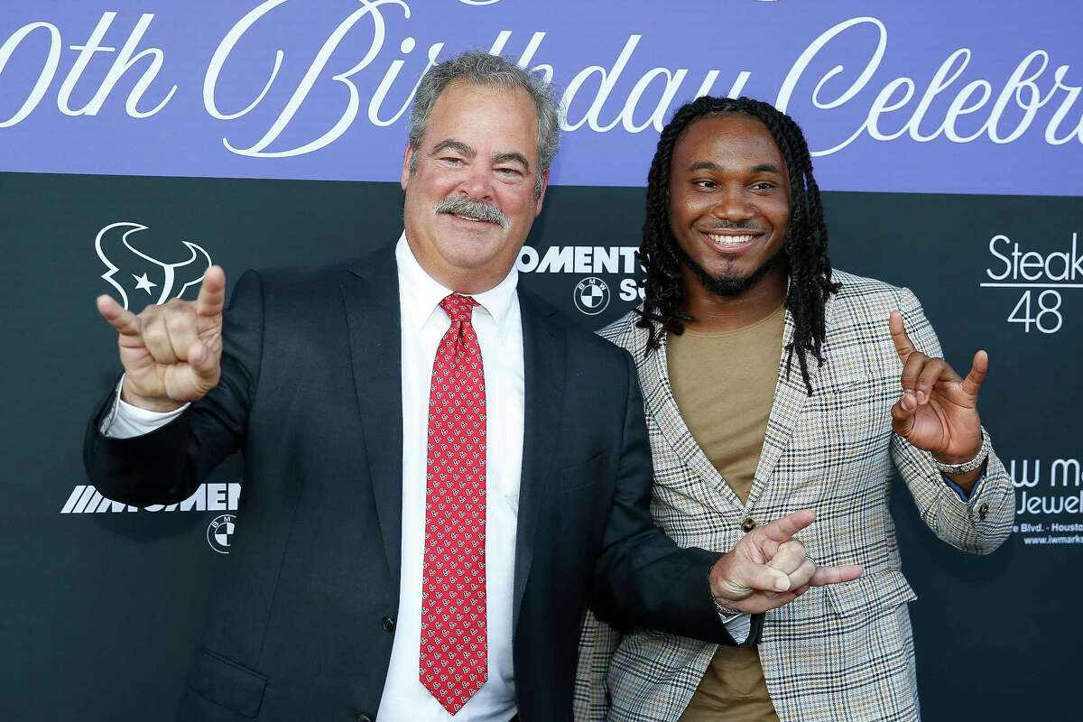 Houston Texans running back D'Onta Foreman, right, and Texans chairman and chief operating officer Cal McNair arrive at the March of Dimes' 80th Birthday Celebration hosted by the McNair Family and Houston Texans at Steak 48 Monday Sept. 24, 2018 in Houston.